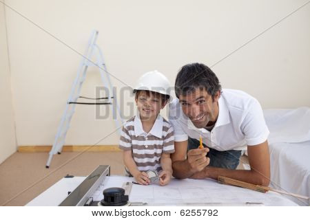 Father And Son Refurbishing A Bedroom