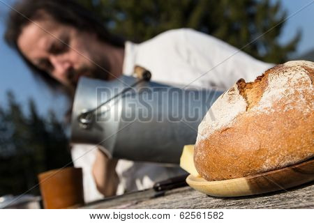 Rural Picnic With Milk Churn And Bread