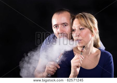 Couple With Electronic Cigarettes