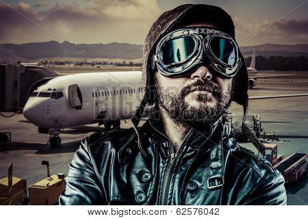 Pride pilot with black leather jacket and old glasses