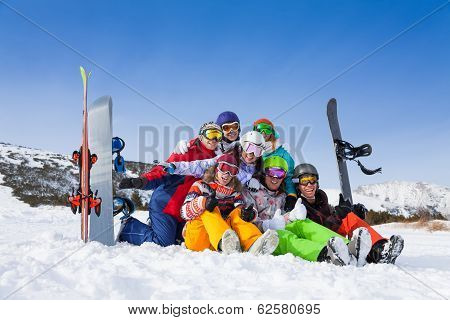 Team with snowboards and skies  wearing goggles