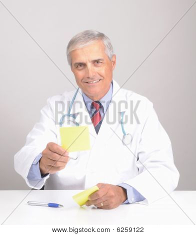 Smiling Middle Aged Doctor In Lab Coat