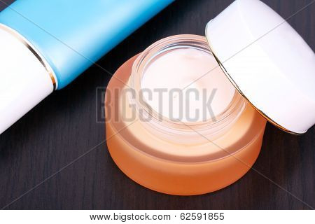 Cream And Bodycare Tube On Black Table