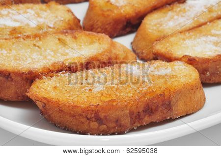 closeup of a plate with torrijas, typical spanish dessert for Lent and Easter