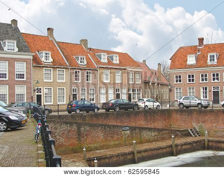 Cars On A Pier In The Dutch Town Of Heusden.
