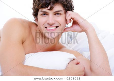 Sexy Smiling Young Nude Man Lying In Bed