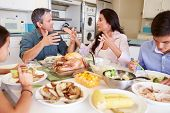 picture of argument  - Family Having Argument Sitting Around Table Eating Meal - JPG