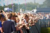 picture of safety barrier  - Crowds Enjoying Themselves At Outdoor Music Festival - JPG