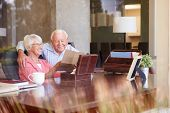picture of keepsake  - Senior Couple Putting Letter Into Keepsake Box - JPG