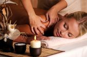 stock photo of massage therapy  - Masseur doing massage on female shoulder in the beauty salon - JPG