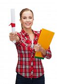 university and education concept - smiling woman with diploma and folders