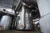 stock photo of sugar industry  - vacuum pans evaporator equipment in a sugar mill - JPG