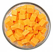 Top View Diced Cheddar Cheese Squares in Bowl Over White