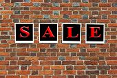 Inscription Sale on the wall from red bricks