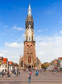 DELFT, NETHERLANDS - MAY 13: People walk near the New Church on May 13, 2013 in Delft. The New Churc
