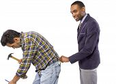 stock photo of white collar crime  - Businessman Stealing from a Blue Collar Worker - JPG