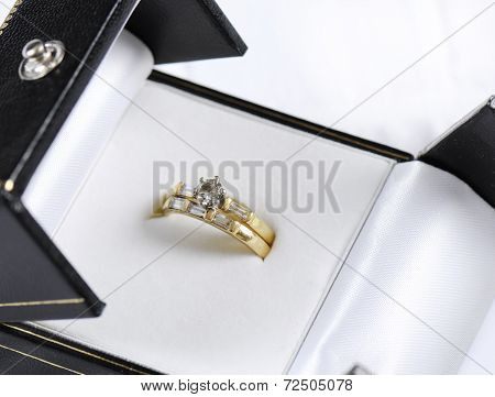 Wedding And Diamond Engagement Rings In Opened Jewelry Box Closeup Macro