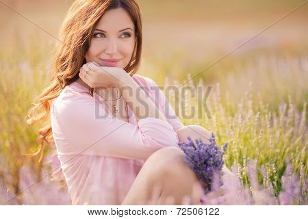 Young woman in a field of lavender.