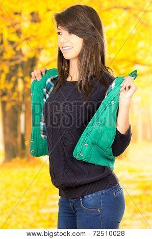 Portrait of beautifiul young brunette girl in autumn