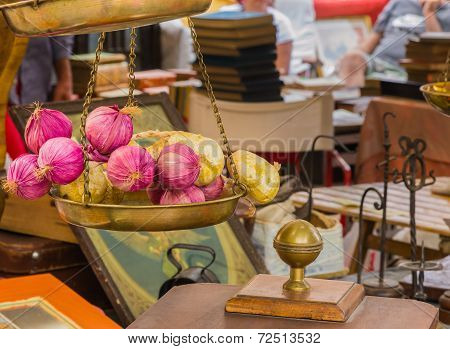 Artificial Onions On An Antique Scales