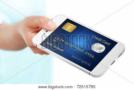 Hand Holding Mobile Phone With Credit Card Isolated Over White