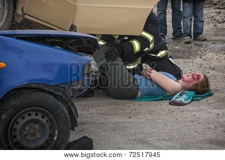 Firefighters Saving The Bleeding Woman From A Crashed Car