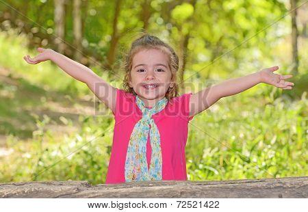 Little Girl Enjoying And Raising Her Hands