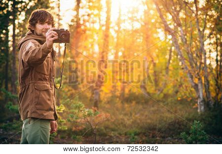 Young Man with retro photo camera outdoor Lifestyle