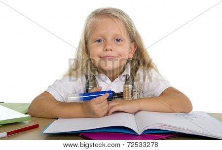 Sweet Little Schoolgirl Sitting At Desk Drawing With Marker