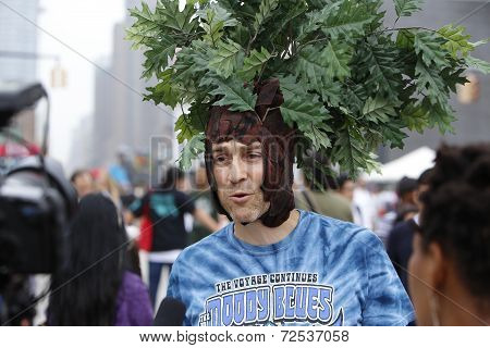 Man with foliage hat