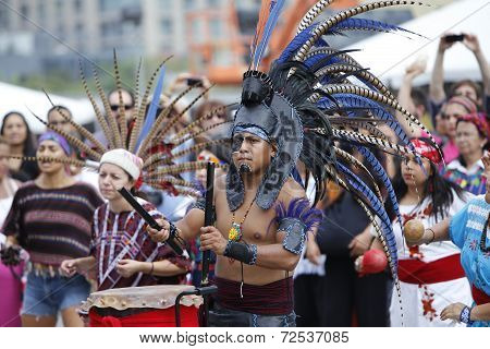 Aztec performers in costumes