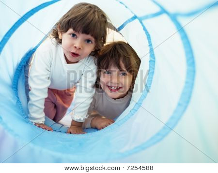 Two Little Girls Playing In Kindergarten
