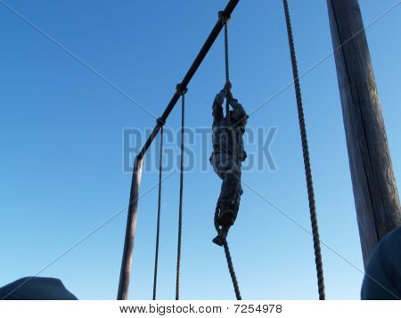 Soldier climbing rope