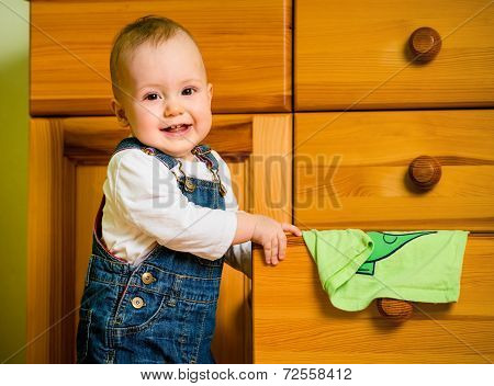 Domestic chores - baby at drawer