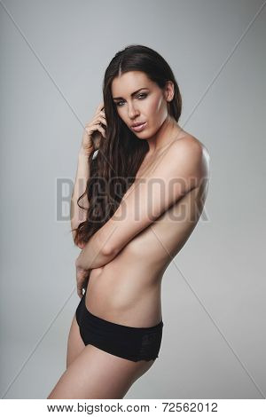 Topless Young Woman Posing On Grey Background