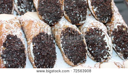 Sicilian Cannoli With Bits Of Chocolate And The Sweet Cream