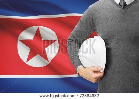 Architect With Flag On Background  - North Korea