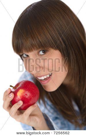 Happy Teenager In Pajamas Eating Healthy Apple