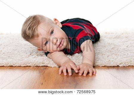 Cute Baby Boy On The Carpet