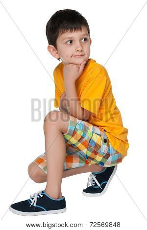 Pensive Little Boy In The Yellow Shirt