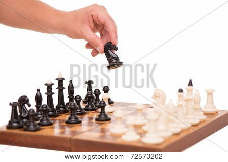 Close-up of chess and hand