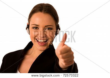 Preety Happy Asian Caucasian Business Woman With Headset Showing Thumb Up As A Gesture For Success