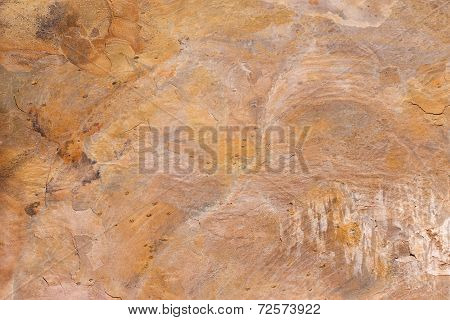 Pattern of a stone plate in yellow, ocher, beige, brown