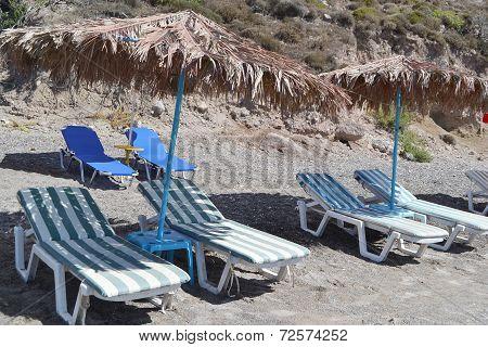 Sunbeds And Umbrellas On Beach