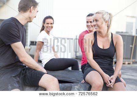 Happy workout team taking a break outdoor