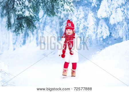 Little Girl Running In A Snowy Park