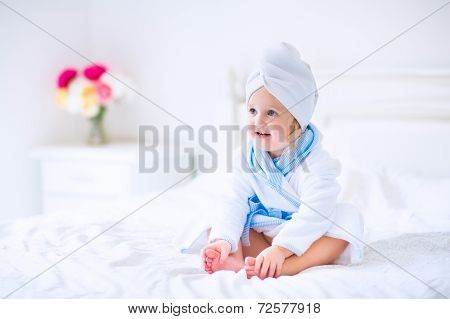 Sweet Litlte Girl In A Bathrobe And Towel