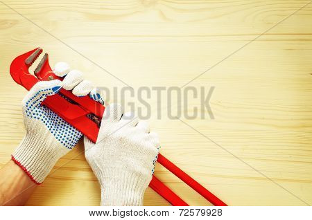 man holding the monkey wrench