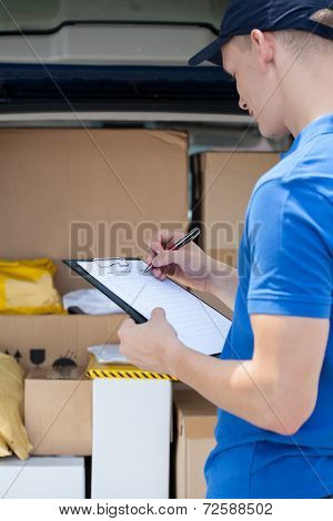 Delivery Guy Filling In Documents