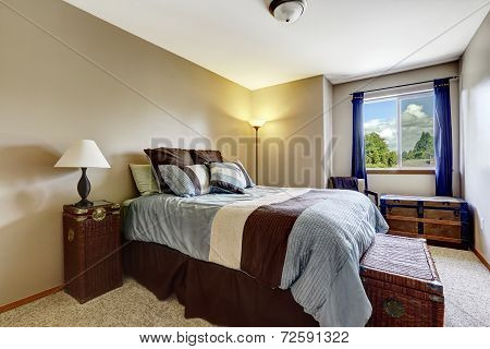 Bedroom Interior With Wicker And Antique Chests